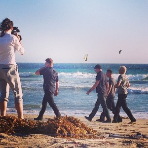 U2 walking on beach